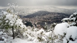 Kastoria, a scenic town on the hillside in Greece, features in a Greek tourism promotion website.