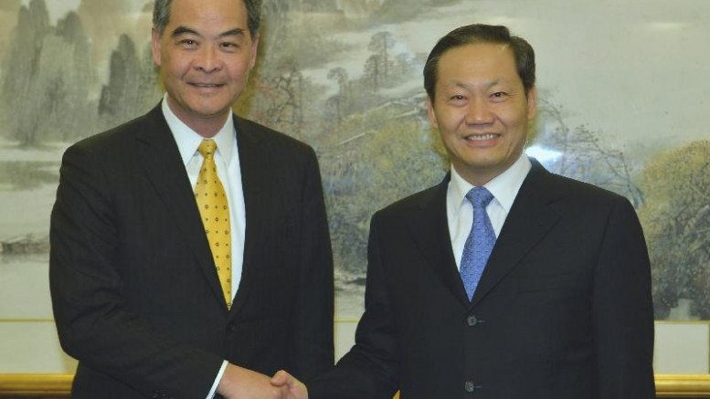 Chief Executive Leung Chun-ying finds time to meet with Peng Qinghua, party chief of Guangxi. Peng had worked as deputy head of the Central Government's Liaison Office in Hong Kong.