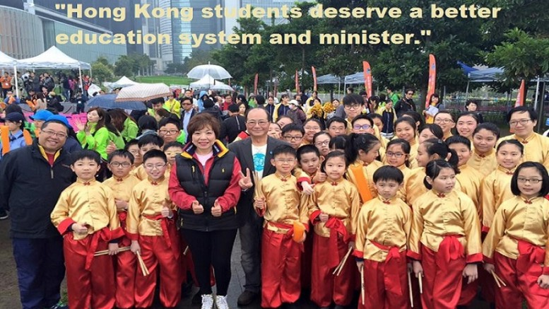 Education minister Eddie Ng with a group of students. He is in hot  water again for his deeds and words.