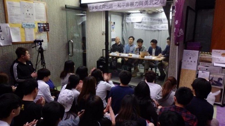 A group of activists including pro-independence Hong Kong National Party convenor Chan Ho-tin attend a forum at Academy of Performing Arts. Will such talk be banned in future?