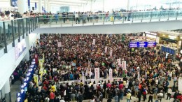 More than 2,500 cabin crew and supporters greet visitors at the Hong Kong International Airport with a sit-in to vent out their anger over the 'luggage-gate' row surrounding Chief Executive Leung Chun-ying and his daughter. They fear flight airport is compromised in Leung's alleged abuse of power.