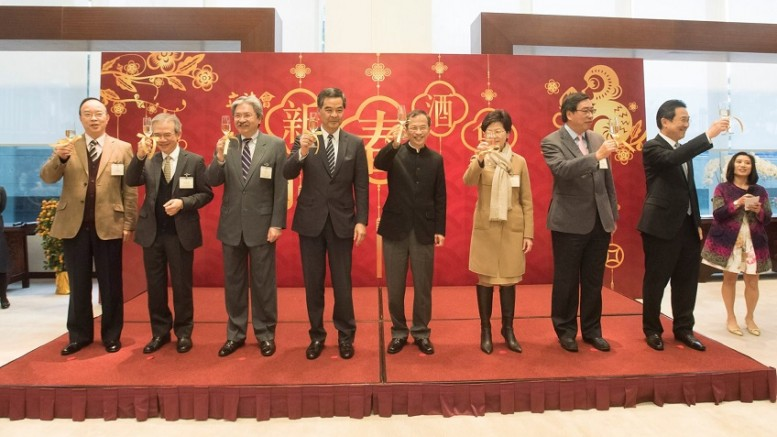 Chief Executive Leung Chun-ying joins Legco President Tsang Yok-sing to propose a toast at a Chinese New Year reception.