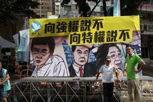 Democrats ridicule the alleged abuse of powers by Chief Executive Leung Chun-ying at the July 1 rally.
