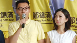 Cheng Kam-mun (left) of the Civic Passion, who signs a confirmation note in his nomination for Legco poll, was asked by election office to explain his pro-independence stance by Wednesday.