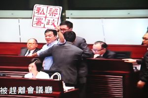 Pan-democratic legislator Chan Chi-chuen stages protest at Chief Executive's Question Time at Legco.
