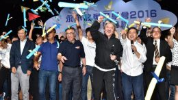 Financial Secretary John Tsang mingles with young people at a ceremony.