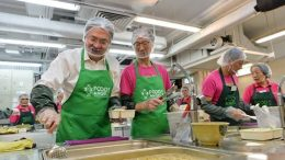 Financial Secretary John Tsang joins his predecessor Antony Leung at a charity project organised by Food Angel. Both are tipped as hopefuls for the next chief executive.