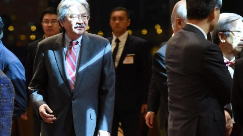Chief Executive Leung Chun-ying and Financial Secretary John Tsang Chun-wah do not see eye to eye at a reception. They clash over whether to take questions from four lawmakers whose status is the subject of a judicial review filed by the Leung administration.