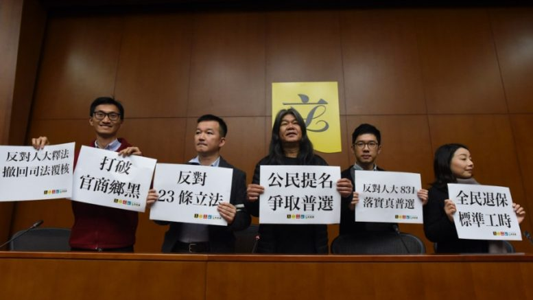 'Long hair' Leung Kwok-hung (middle) launches an online civic nomination campaign to seek support for joining the chief executive election.