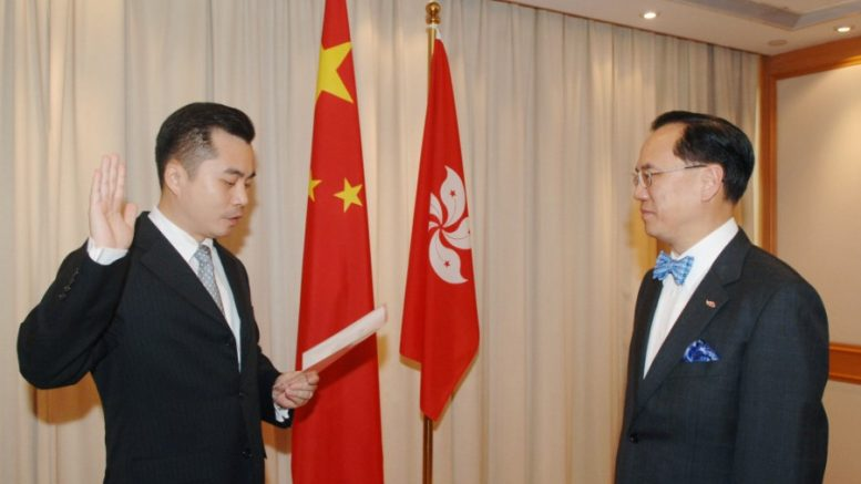 Wong Yan-lung is sworn in as secretary for justice at a ceremony presided by former chief executive Donald Tsang in 2005.