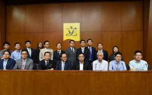 Pan-democrat legislators stand united to defend Kenneth Leung, who faces calls by Chief Executive Leung Chun-ying for him to quit a Legco probe into the UGL case.