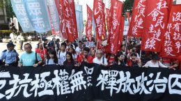 Angry Hongkongers stage a protest against the jailing of four student leaders.