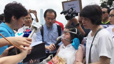 Chief Executive Carrie Lam  receives a petition from a patients' group on her 100th day in office.