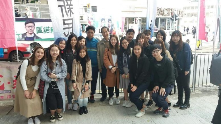 Shue Yan journalism students take picture and Martin Lee during a visit to a vote-canvassing site in the Legco by-election in March.