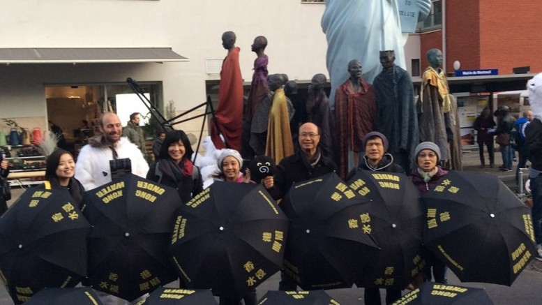 Delegates of Hong Kong NGOs attending the Paris Climate Talks call for action on climate change.