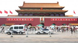 Portrait of late Chairman Mao Zedong looms over Tiananmen Square - a sign pop singer Cui Jian says showing the Cultural Revolution is not yet finished.