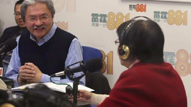 Financial Secretary John Tsang Chun-wah attends a Commercial Radio programme on his just-announced Budget.