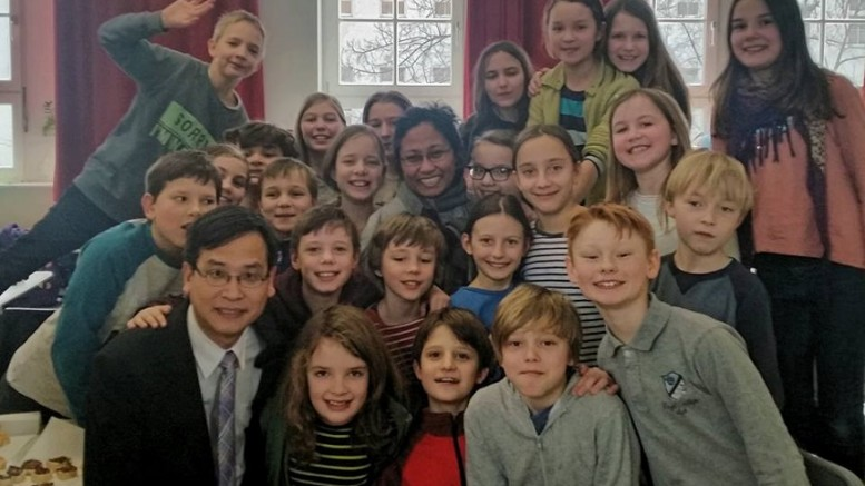 Legislator Ip Kin-yuen and a group of Grade 5 pupils in Germany. Ip proposes a host of measures to ease pressure on teachers and students.
