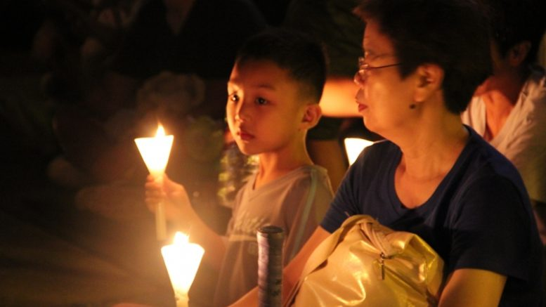 The candle lights still shine  at the Victoria Park on June 4. More than 125,000 people attended the rally. Police said less than 30,000 turned out at the peak of the rally.