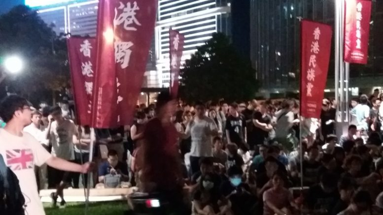 Thousands of people attend a pro-independence rally at the Tamar Park on Friday.