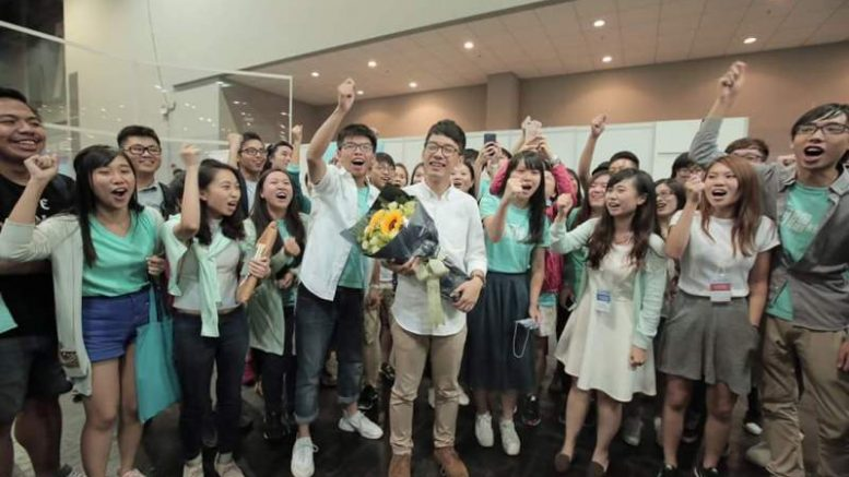 A student group, Demosisto, celebrates the victory of their co-founder, Nathan Law, a former Occupy Central student leader, in the Legco election.