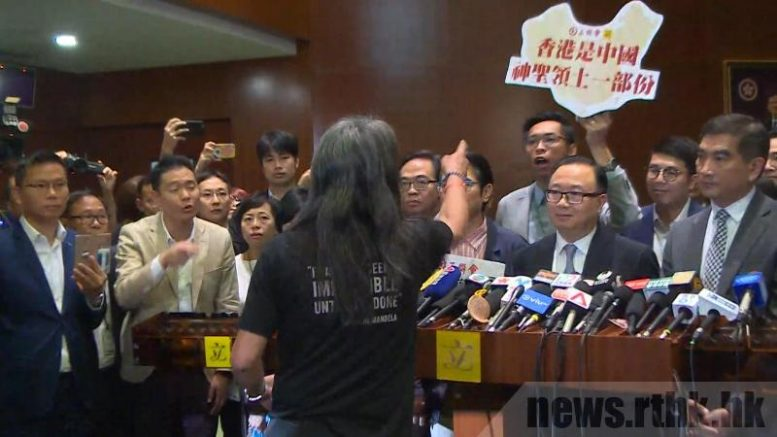 'Long Hair' Leung Kwok-hung is locked in a war of words with pro-establishment lawmakers after they staged a walk-out to block the swear-in of two localist legislators last week.