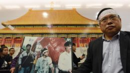 Make no mistake. This is not Tiananmen Square, nor 1989. Democrat Albert Ho, whose headband carried a slogan, 'not to forget June 4', protests at Central MTR station, where an exhibition of Beijing Palace Museum is underway.
