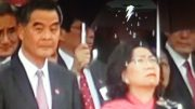 Tong Ching-yee, wife of Leung Chun-ying is visibly upset in rain when Leung follows Liaison Office director to brave the rain at a National Day ceremony.
