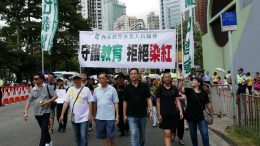 A group of Professional Teachers' Union joins the July 1 rally, protesting against communist influence in education.