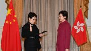 Justice chief Teresa Cheng is sworn in on Saturday as a scandal over illegal structures found in her home erupts.