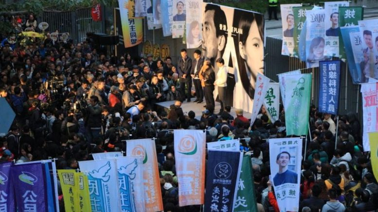 The pan-democrats hold a rally outside Government Headquarters on Sunday to protest against a government decision to ban Agnes Chow, a Demosisto student leader, from contesting a Legco by-election on grounds of her stance on self-determination.