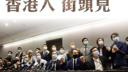 Democrats vow to take to the streets after they quit legislature in protest against the ousting of four lawmakers by Beijing.