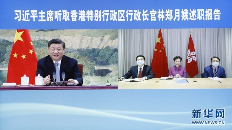 Liaison Office director Luo Huining sits next to Carrie Lam as she reports duty to President Xi Jinping via online.